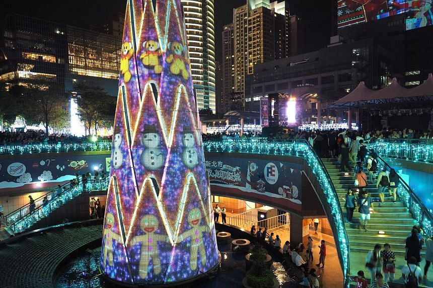 A Christmas tree in Banqiao, New Taipei City, in Taiwan on Saturday. The 36m tree will be lit up every evening until the end of the year, with a 3D projection - designed by Singapore's Hexogon Solution - every half hour.