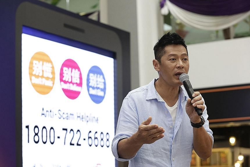 Actor Li Nanxing at the launch of the Anti-Scam Helpline. He will star in a TV commercial that highlights three common scams in Singapore: Impersonation scams, Internet love scams and credit-for-sex scams