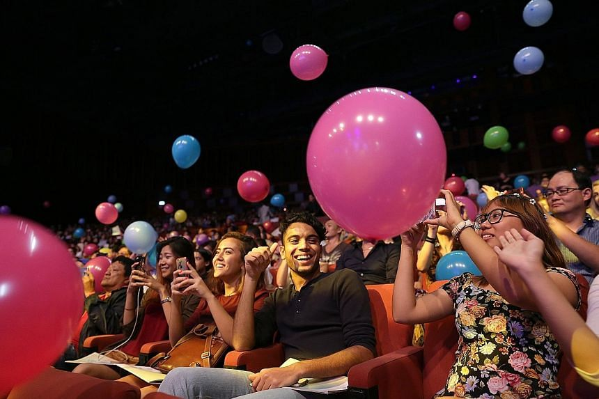 Balloons and confetti released on the 1,500-strong audience near the end of the concert drew gasps of delight.