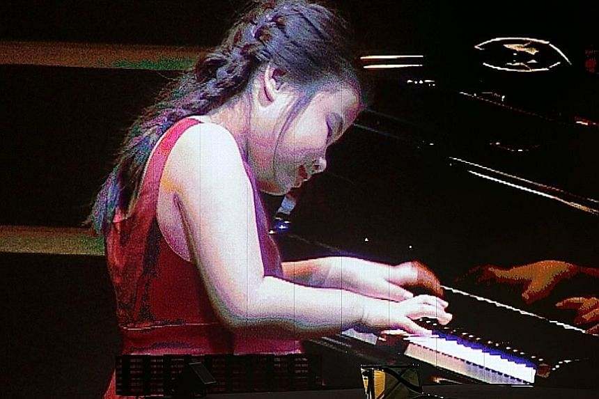 Pianist Chen Jing, seven, wowed the audience with her rendition of Chopin's Waltz No.1 In E Flat Major.