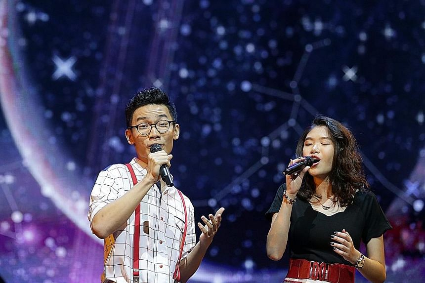 Adam Mark Lim, 17, and Jamie Ho, 15, singing their Moon Medley, comprising Blue Moon, It's Only A Paper Moon, How High The Moon and Fly Me To The Moon, last Saturday.