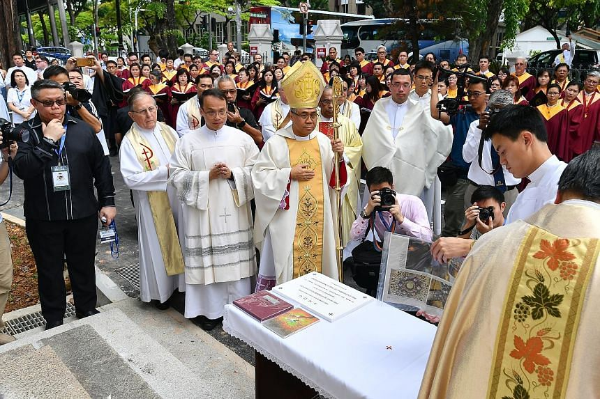 Archbishop Goh yesterday placed a time capsule and commemorative stone to mark the success of the restoration of the Cathedral of the Good Shepherd.