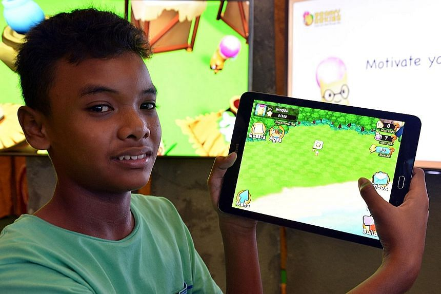 Irfan Shah, 12, playing with Brainy Arkies, a a new mobile learning app by Marshall Cavendish Education aimed at pupils from Primary 1 to 4, consisting of a series of maths quizzes combined with a gaming quest.