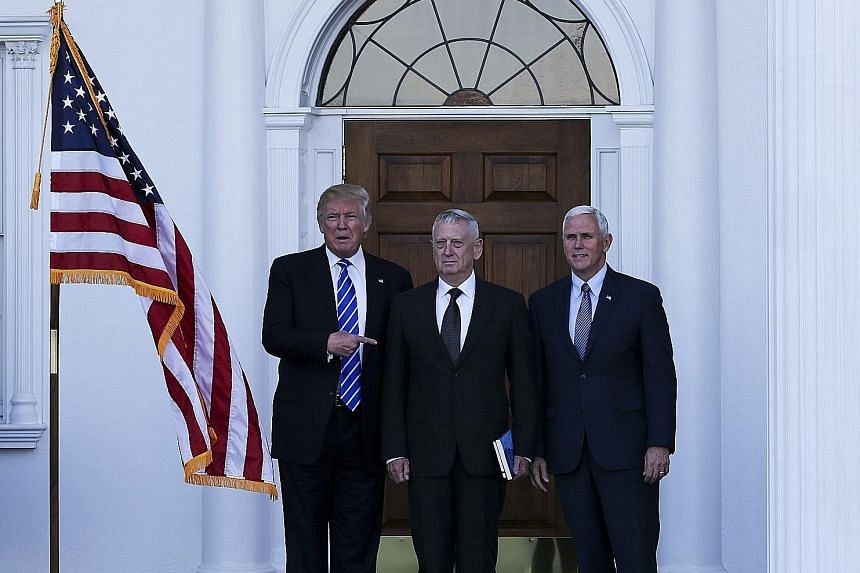 """Left: Retired US Marine Corp General James Mattis flanked by Mr Trump (far left) and Mr Pence at the clubhouse of Trump International Golf Club in New Jersey on Saturday. After their meeting, a Trump team statement said Mr Trump and Mr Pence were """"ve"""