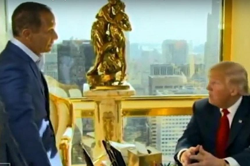 United States President-elect Donald Trump chatting to TMZ founder Harvey Levin in Trump Tower.