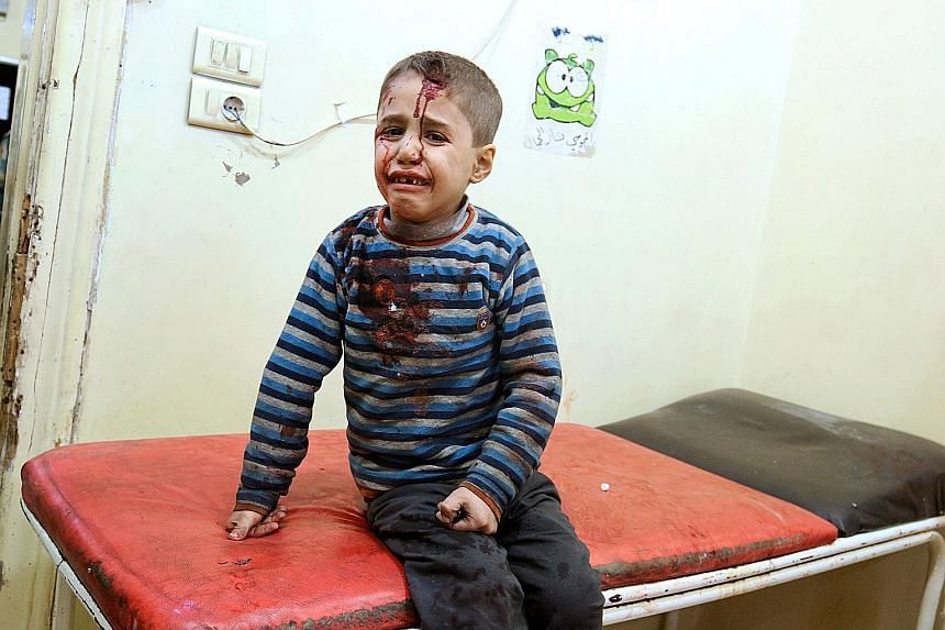 An injured boy inside a field hospital after air strikes on rebel-held areas of Aleppo, Syria, on Friday.