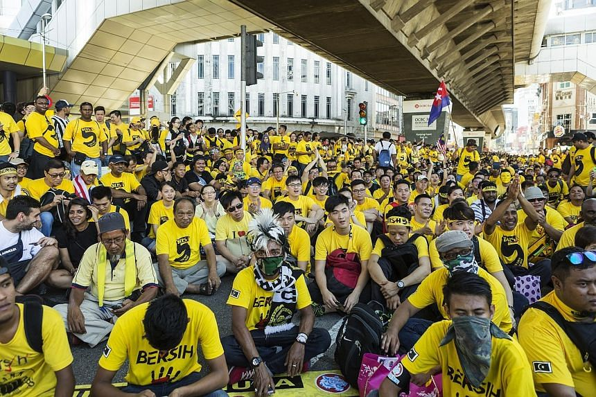 Protesters dressed in yellow gathering near Merdeka Square on Saturday. KL police said 15,500 people turned up although local media reports put the figure at more than double that. The Red Shirts were said to have drawn only 2,500 supporters.