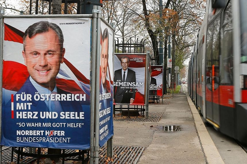Campaign posters of Mr Hofer (left) and Mr Van der Bellen. Mr Hofer is hoping to become the EU's first far-right head of state in the Dec 4 poll.