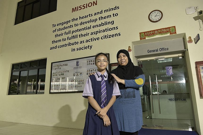 """Madam Iswani and daughter Nasuha, who takes just 10 minutes to walk home from school. """"If I went to a school that is farther way... I won't have enough time to rest,"""" she said."""