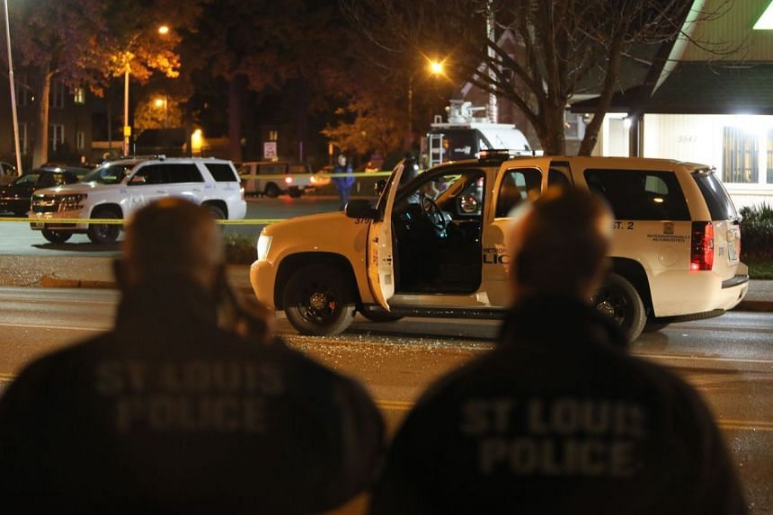 A St Louis police officer was shot twice in the face and critically wounded on Sunday (Nov 20) in an ambush while sitting in his patrol car.