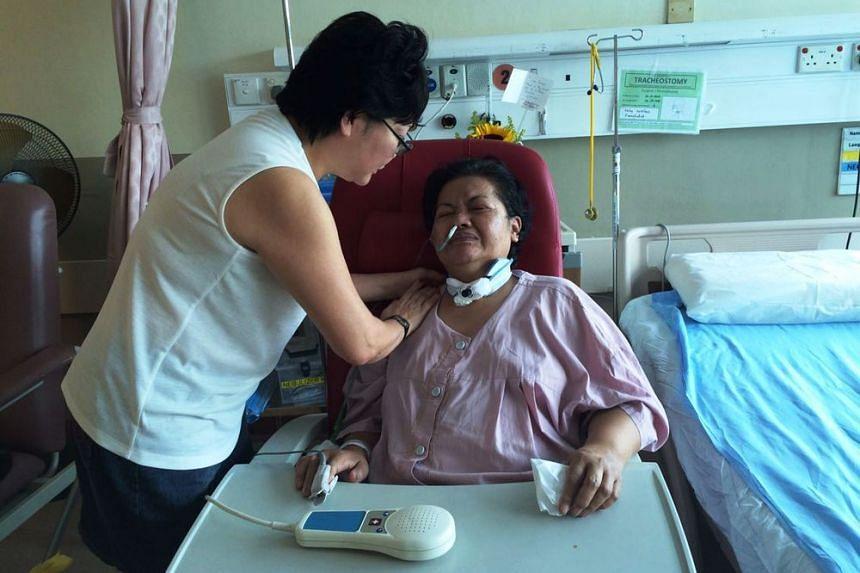 Madam Dora Sern praying for her domestic helper Felicidad Muna Mico in hospital.