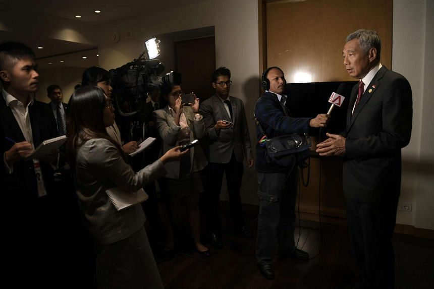 Prime Minister Lee Hsien Loong speaks to the Singapore media after the Apec summit.