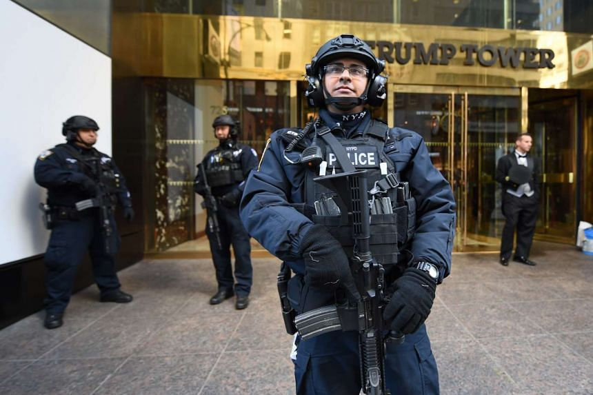 A member of the New York Police Department stands in front of Trump Tower on 5th Avenue to provide security to US President-elect Donald Trump on Nov 10, 2016 in New York.