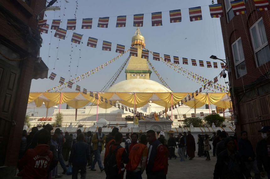Buddhist devotees visit Boudhanath Stupa as it reopens after renovation for earthquake damage on the outskirts of Kathmandu on Nov 22, 2016.