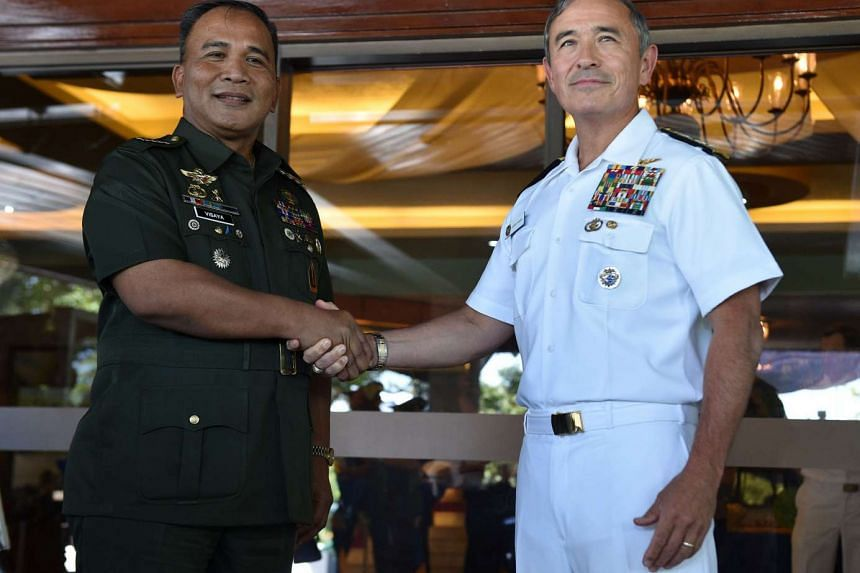 Philippine military chief General Ricardo Visaya (left) shakes hands with US Pacific Command commander Admiral Harry Harris, after the Philippine-US Mutual defense Board (MDB) meeting in Manila on Nov 22, 2016.
