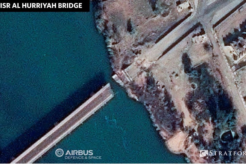 A destroyed section of the Jisr al Hurriyah Bridge crossing the Tigris River is seen in Mosul, Iraq, in this satellite image released Nov 18, 2016.
