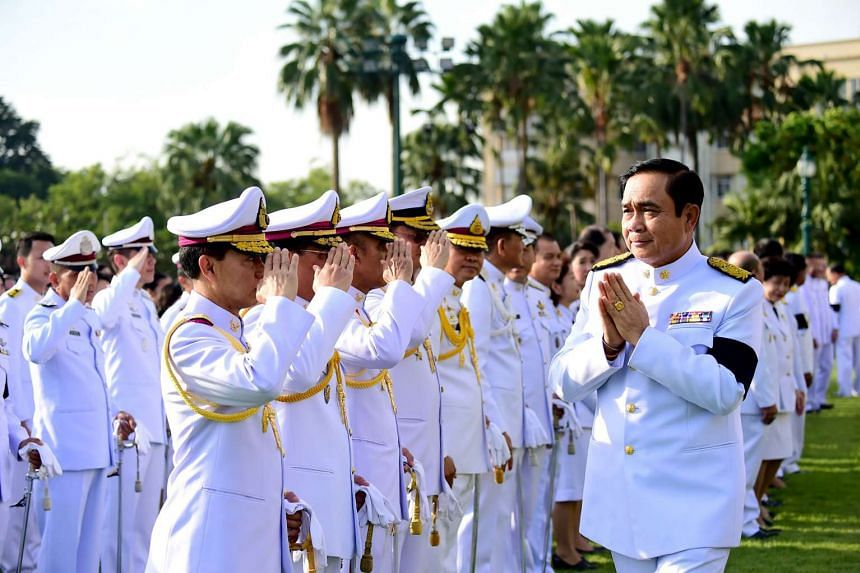 This handout photo taken and released by the Royal Thai Bureau on Nov 22, 2016 shows Thai Prime Minister Prayuth Chan-O-Cha saluting officials before presiding over a mass pledge of allegiance to the late Thai King Bhumibol Adulyadej during a ceremon