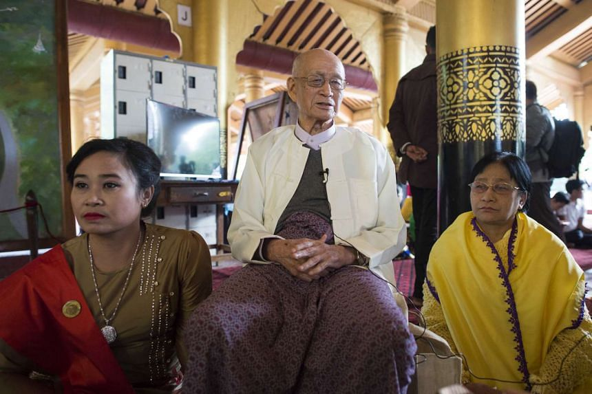 Taw Phaya (center), 93, the grandson of King Thibaw, looks on with relatives at Mandalay's Golden Palace on November 22, 2016 to mark the exile anniversary of their royal ancestor.