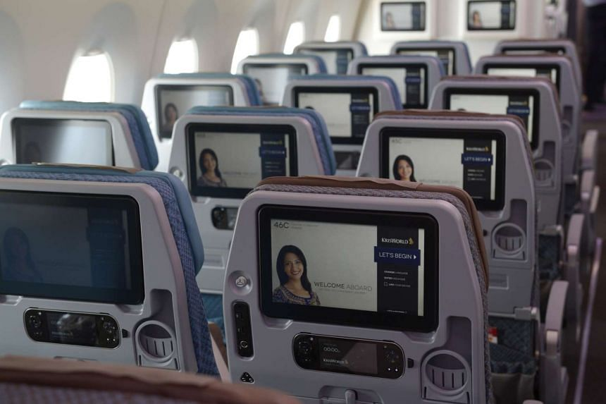 The in-flight entertainment systems in the economy class cabin of a Singapore Airlines plane.