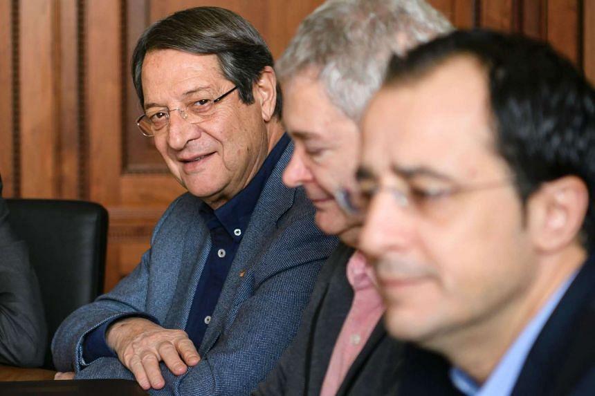 Greek Cypriot leader Nicos Anastasiades (left) looks on during Cyprus Peace Talks on Nov 20, 2016 in Mont-Pelerin, western Switzerland.
