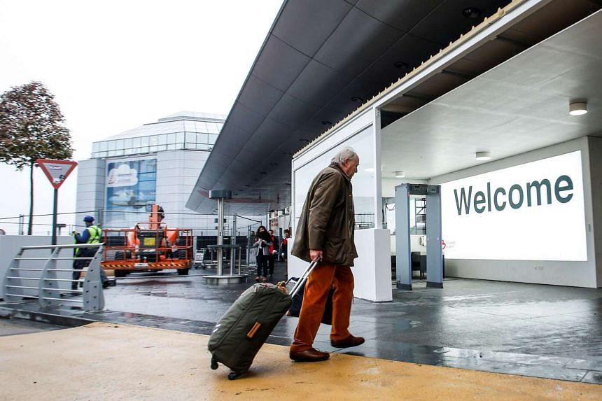 A man enters Brussels Airport in Zaventem by a new double-door entrance set up following new security measures, on Nov 7, 2016.