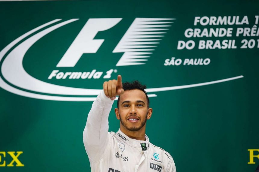 British Formula One driver Lewis Hamilton, of Mercedes, celebrates after winning the Formula One Grand Prix of Brazil.