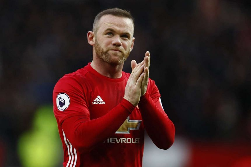 Manchester United's Wayne Rooney applauds the fans after the match against Arsenal at the Old Trafford on Nov 19, 2016.