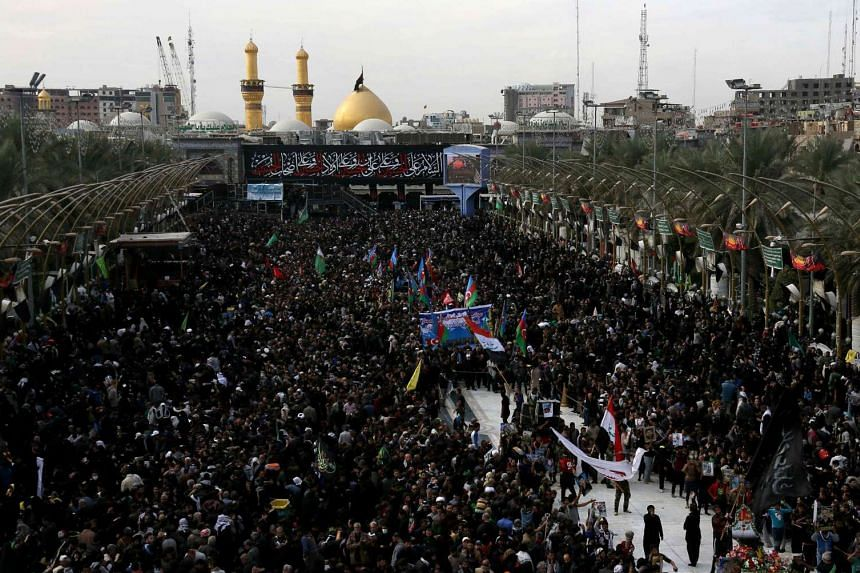 Shiite Muslim pilgrims gather outside the Imam Hussein shrine on the last day of the Arbaeen religious festival on Nov 21, 2016, in the holy Iraqi city of Karbala, 80 kilometres south of Baghdad.