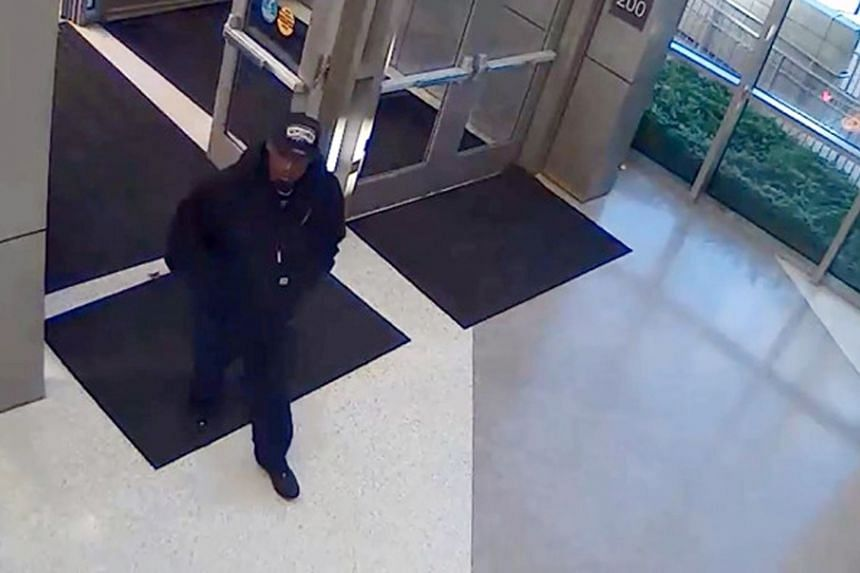 A man identified by the San Antonio Police Department as a suspect in the shooting death of police detective Benjamin Marconi, 50, is seen entering the police headquarters building in San Antonio, Texas, on Nov 20, 2016.