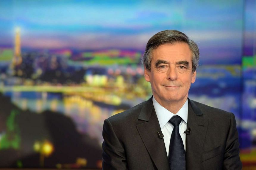 Former French prime minister Francois Fillon takes part in the TV news of French TV channel TF1.
