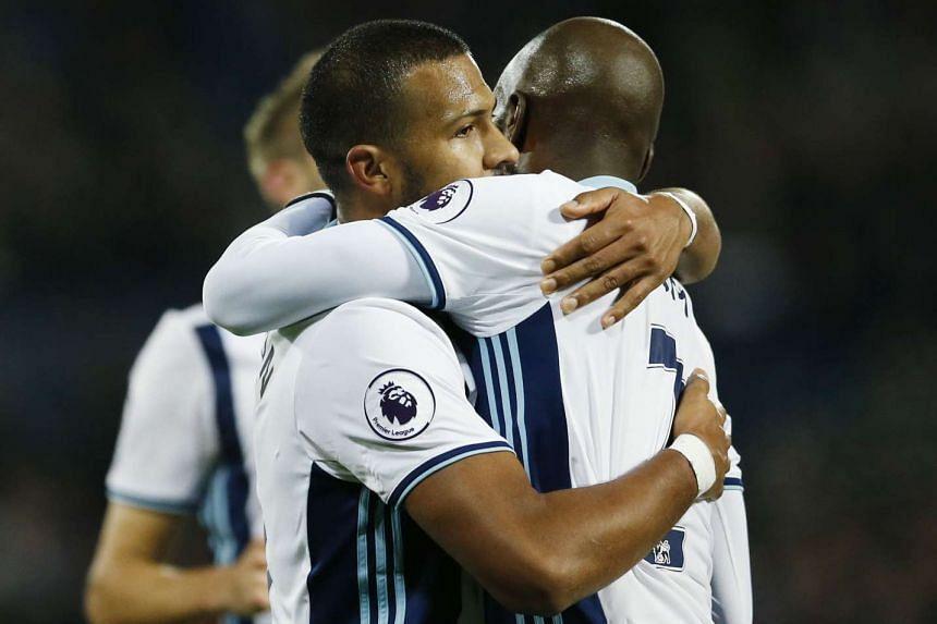West Bromwich Albion's Salomon Rondon celebrates scoring their fourth goal with Allan Nyom.