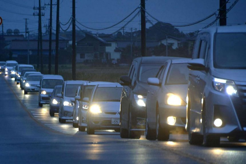 A traffic jam is seen as people evacuate after tsunami advisories were issued following an earthquake, in Iwaki, Fukushima prefecture, on Nov 22, 2016.