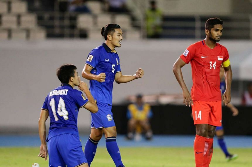 Sarawut Masuk (left) and Adison Promrak (center) of Thailand celebrate after Masuk's goal against Singapore during the  Suzuki Cup match between Thailand and Singapore at the Philippine Sports Stadium on Nov 22, 2016.