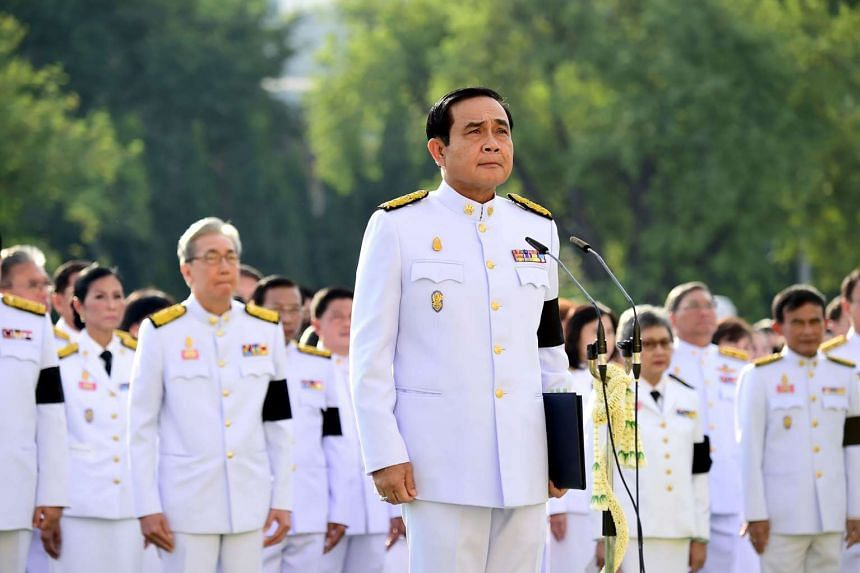 Thai Prime Minister Prayuth Chan-O-Cha presiding over a mass pledge of allegiance to the late Thai King Bhumibol Adulyadej during a ceremony at the Government House in Bangkok on Nov 22, 2016.