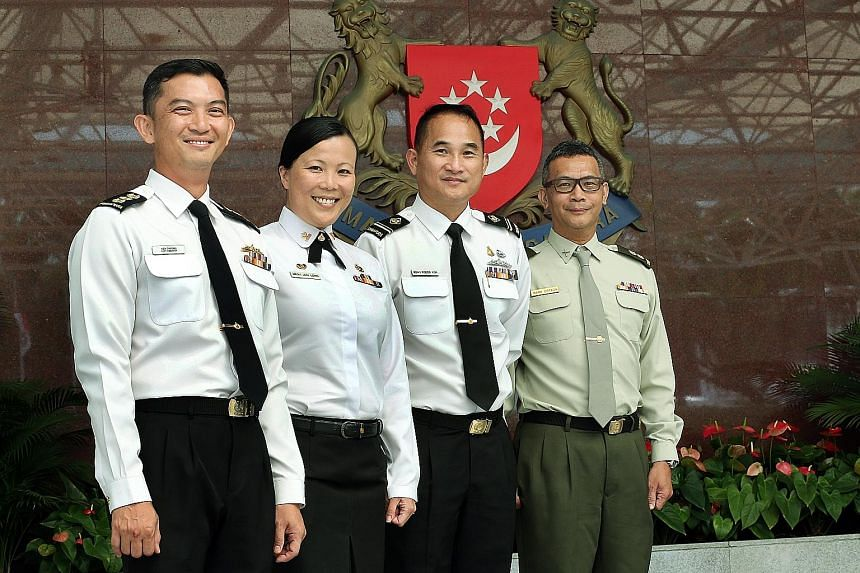 Among those who received the medal are (from left) Colonel Cheong Kwok Chien, Military Expert 3 Long Lin Jun, Military Expert 4 Roger Koh Kwang Hui and Lieutenant- Colonel (NS) Mark Benjamin Ortega.