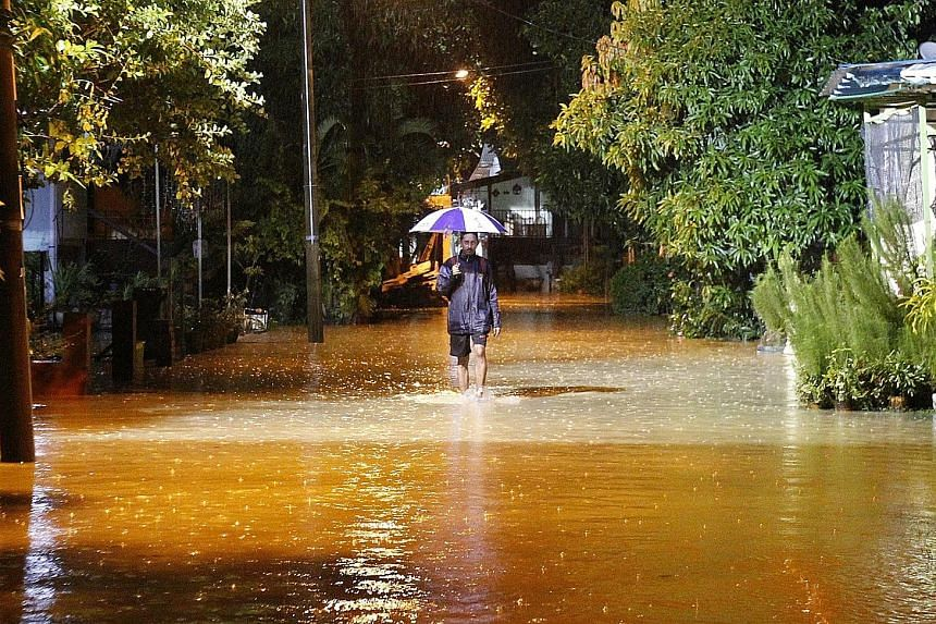 Floodwaters in Kampung Makam in Penang. A 42-year-old man died after he slipped into the Prai River in mainland Penang and drowned.