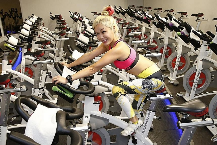 Ms Lee balances her love of food with a variety of exercise routines, including indoor cycling, to keep herself motivated.