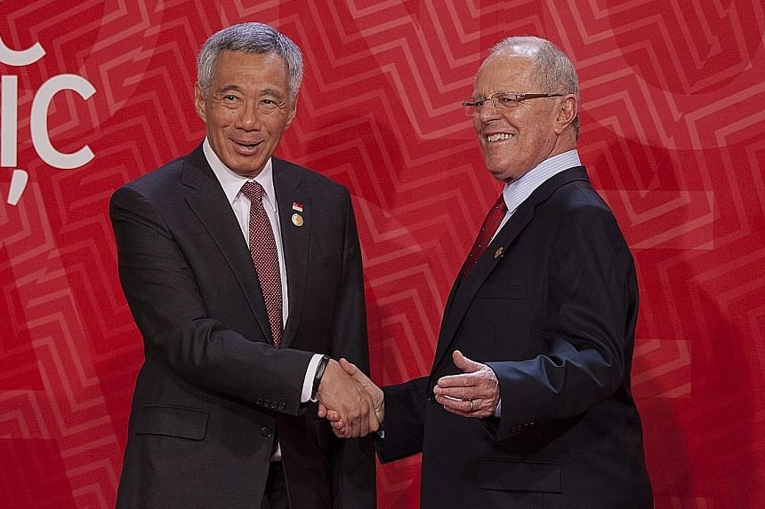 PM Lee Hsien Loong with Peru's President Pedro Pablo Kuczynski at the Apec Leaders' Retreat on Sunday, the last day of the Asia-Pacific Economic Cooperation Summit in Lima.
