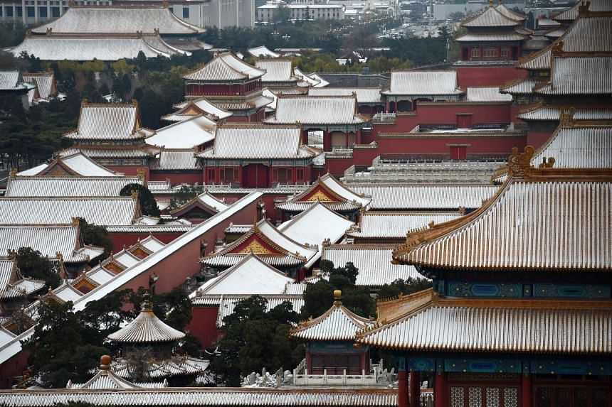 The rooftops of buildings in Beijing's Forbidden City were covered with the first snow of the season yesterday. More than 80 flights leaving from and arriving at the Beijing Capital International Airport were cancelled yesterday owing to the cold wea