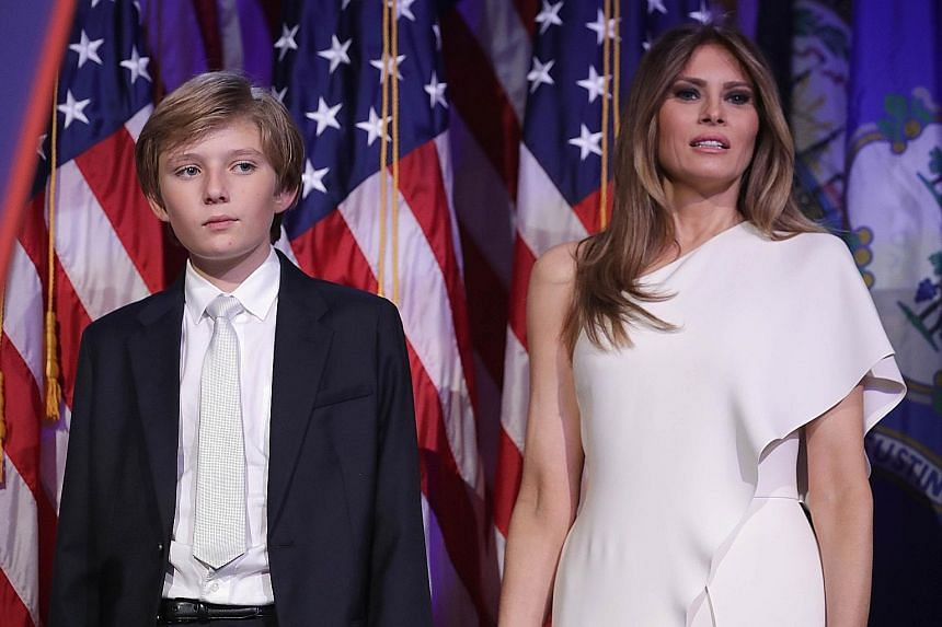 Mrs Trump and her son Barron on stage at the New York Hilton Midtown following Mr Trump's victory in the Nov 8 election. The President-elect's wife and son will not move to the White House for at least six months following his inauguration in January