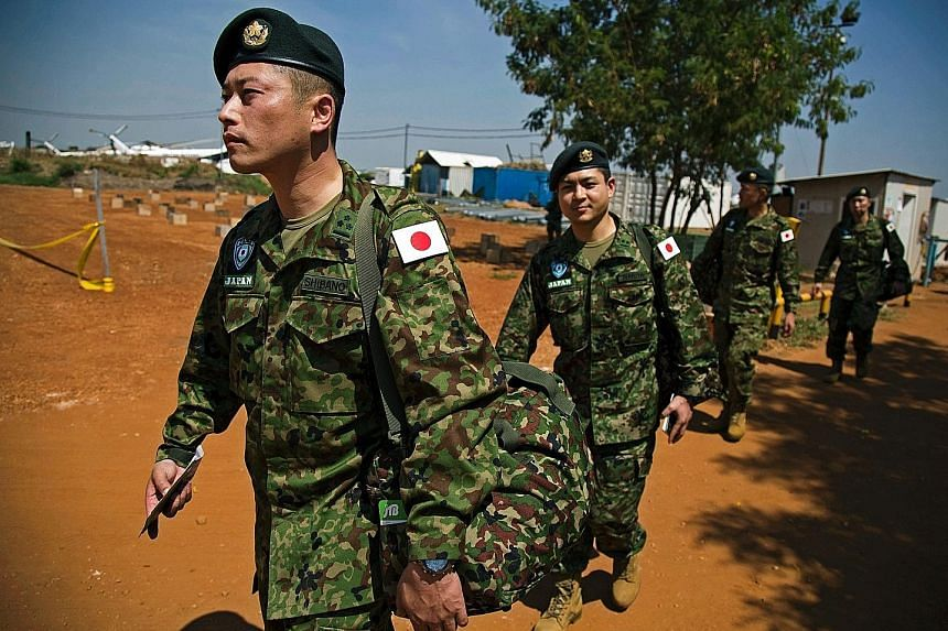 Members of the Japanese Ground Self-Defence Force arriving at the base of the United Nations peacekeeping mission in Juba, South Sudan, yesterday. The deployment of 350 soldiers is in line with Japanese security legislation to expand the military's r