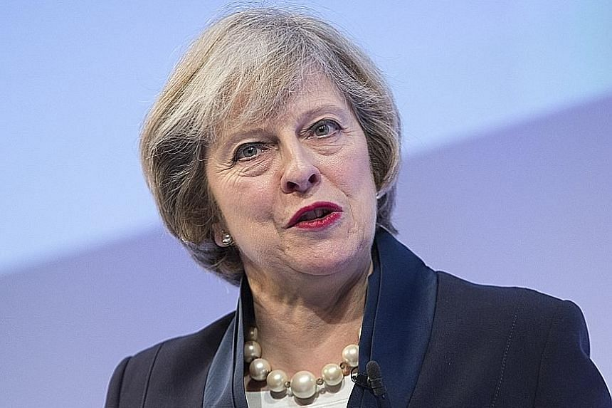 Mrs May also moved to ease concerns among company bosses who had been alarmed by a plan to put workers on boards and to tackle excessive executive pay.