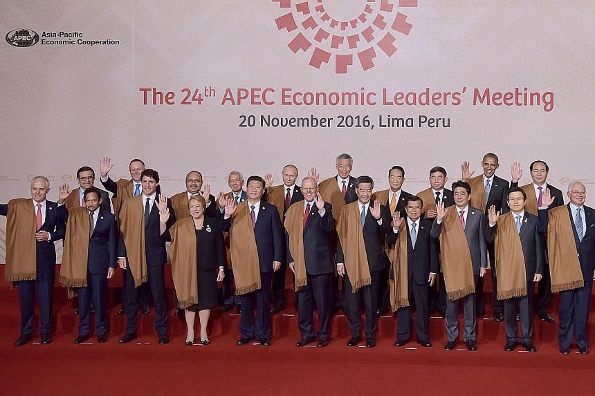 Apec leaders posing for a family photo in Lima on Sunday. They are (front row, from left) Australia's Prime Minister Malcolm Turnbull, Brunei's Sultan Hassanal Bolkiah, Canada's Prime Minister Justin Trudeau, Chile's President Michelle Bachelet, Chin
