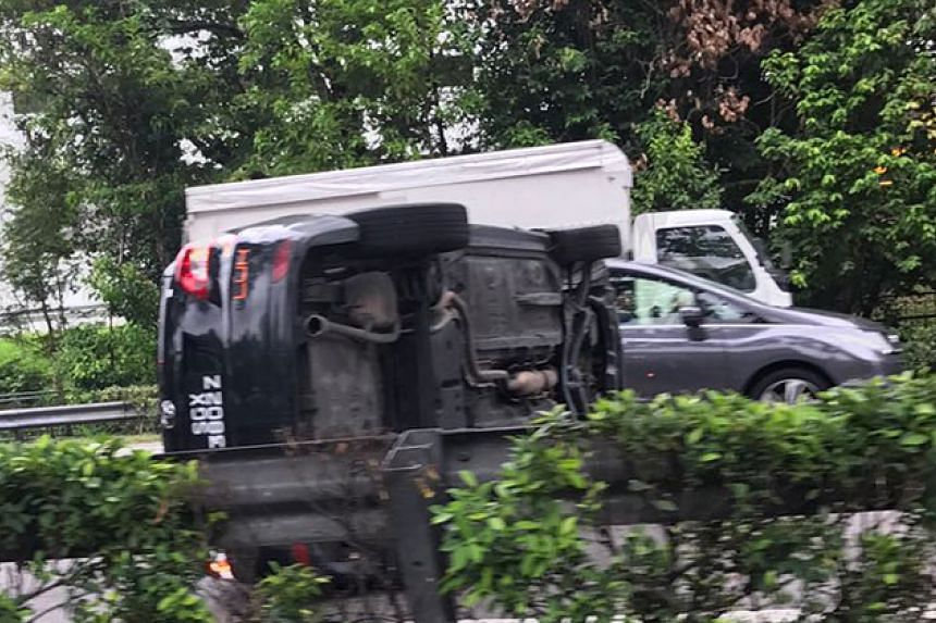 A car flipped on its side along the Central Expressway (CTE) on Tuesday (Nov 22) morning.