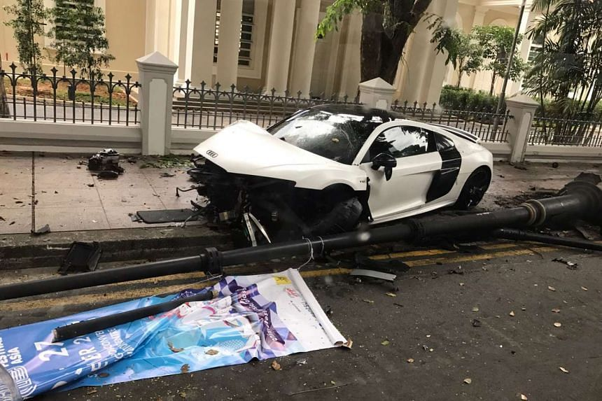 The front of the white Audi R8 V10 was completely smashed after the accident along Bras Basah Road.