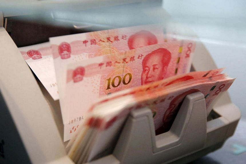 Chinese 100 yuan banknotes are seen in a counting machine.
