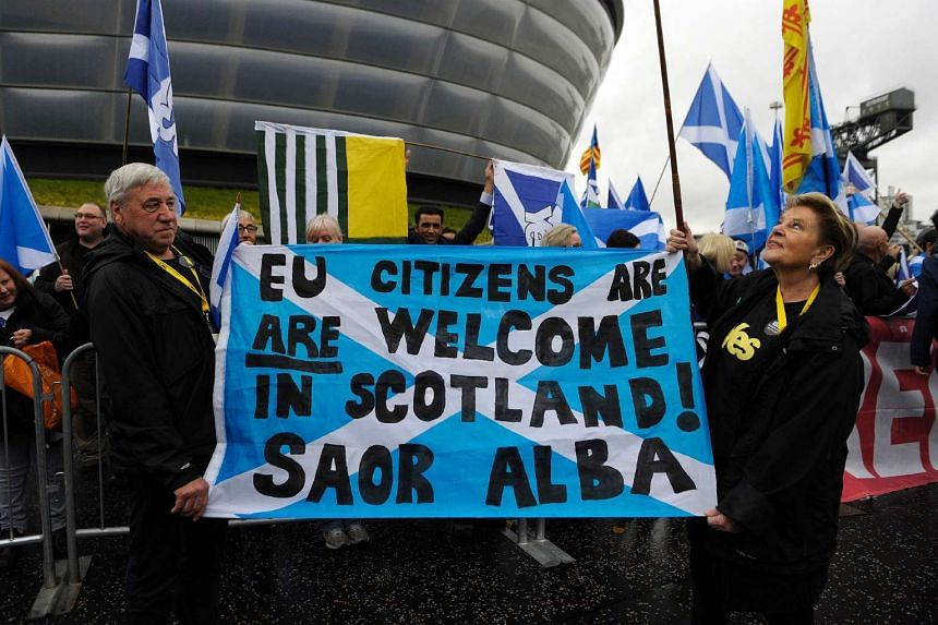 Pro-Independence campaigners stage a rally outside the Scottish National Party (SNP) Conference in Glasgow, Scotland on October 15.