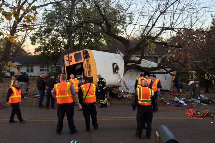Rescue officials at the scene of a school bus crash involving several fatalities in Chattanooga, Tennessee.