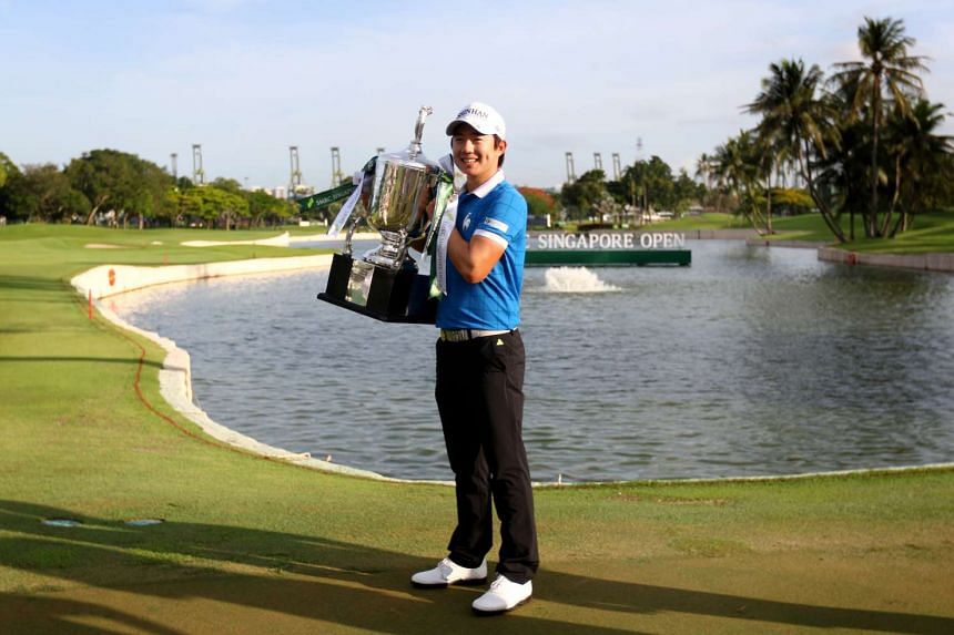 Song Young Han holding the champion trophy of the 2016 SMBC Singapore Open held at Sentosa Golf Club's Serapong Course.