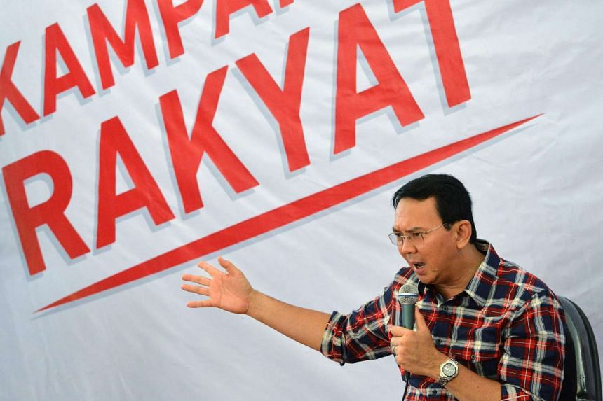 Jakarta's governor Basuki Tjahaja Purnama, who is also a member of Indonesia's ethnic Chinese minority, gestures as he speaks to residents during his campaign for the next round of the governor elections in Jakarta.